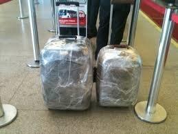 mala com plástico - segurança extra